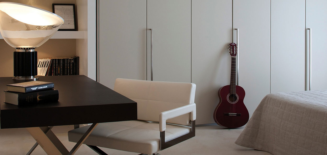 Modern bedroom design complete with great Italian furniture in remodeled duplex apartment designed by Ernesto Fusco