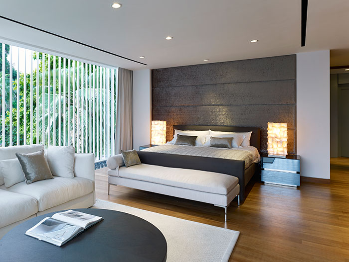 Modern bedroom in stunning Sentosa Cove holiday retreat for a multi-generational Chinese family