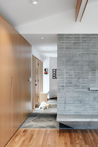 Modern corridor and fireplace in remodeled 1967 house near Seattle