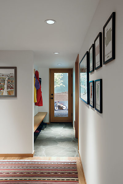 Modern corridor in remodeled 1967 house near Seattle by SHED Architecture