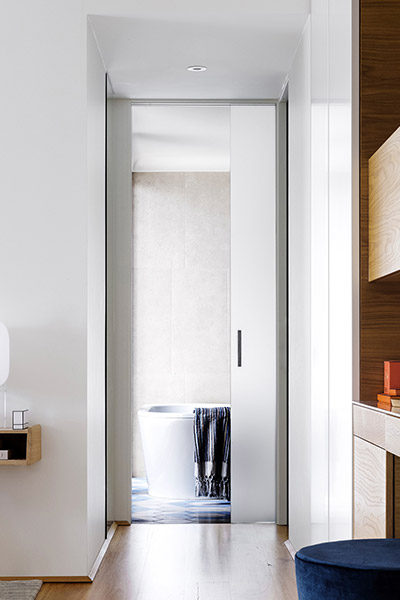 Beautiful modern hallway leading to bathroom inside contemporary Australian home