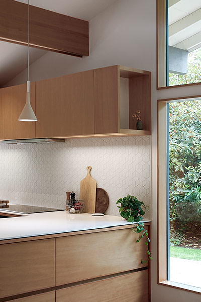 Modern kitchen cabinets for Seattle remodeled residence by SHED Architecture