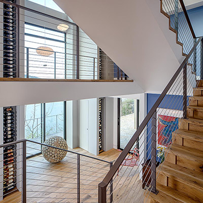 Modern staircase leads to eclectic interior in cliff dwelling near lake Austin, Texas, USA
