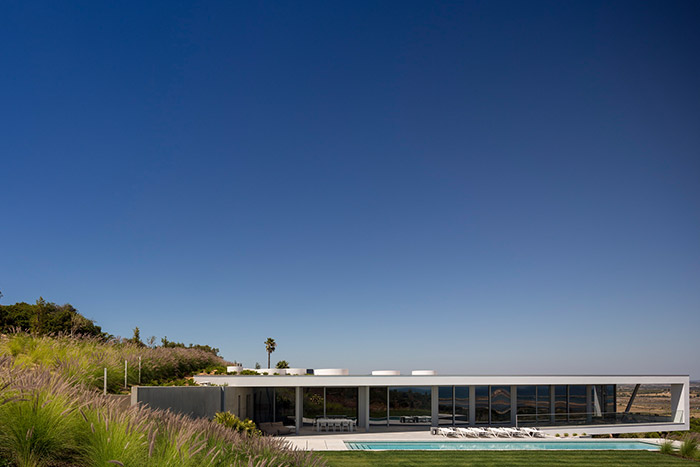 Modern Zauia House by Mario Martins Atelier offers stunning views of Lagos Bay; great example of Portuguese architecture