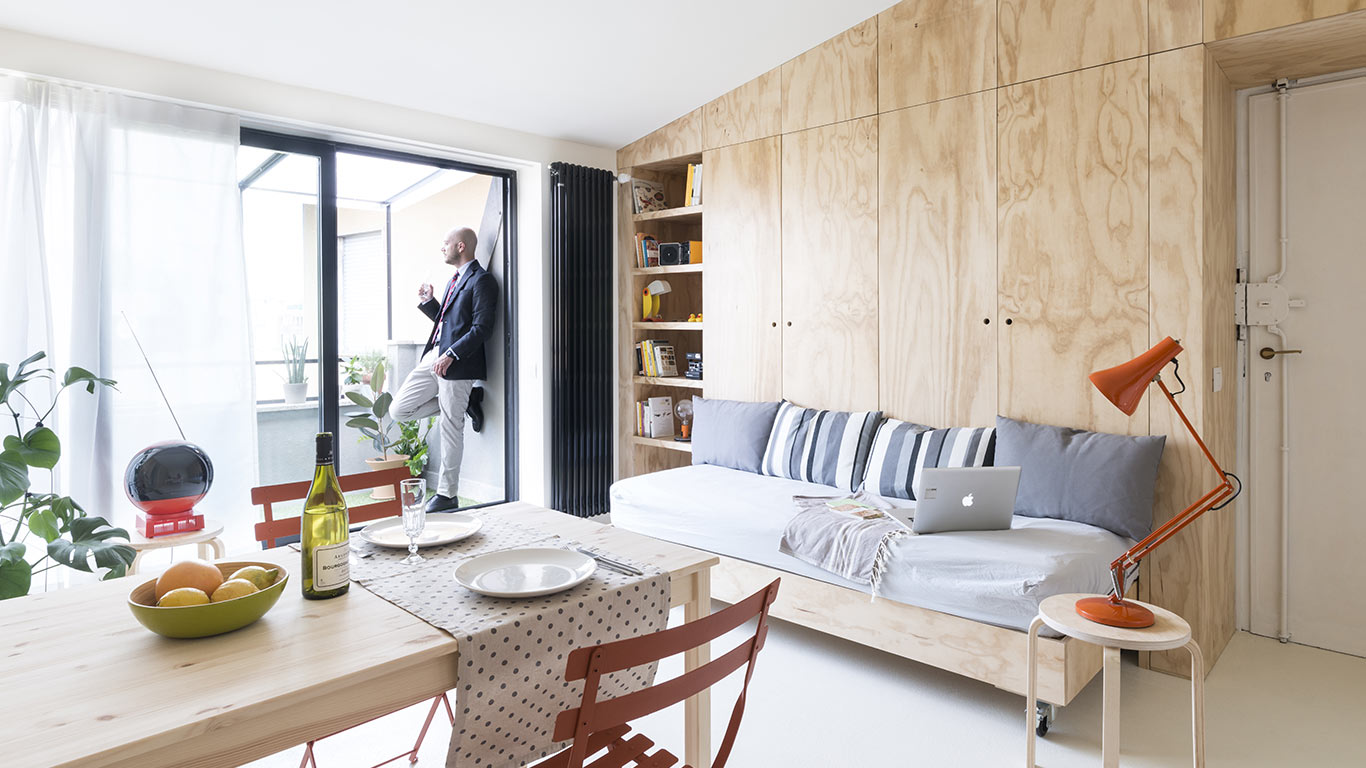 Multifunctional furniture makes this small apartment in ...