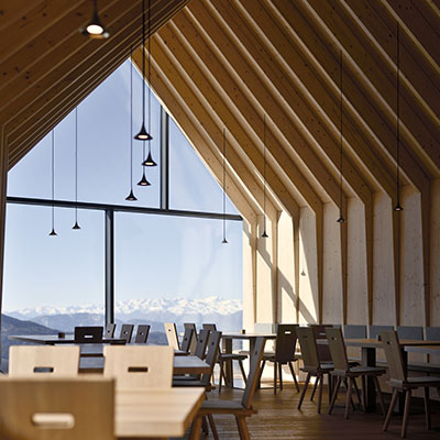 Located in Italy, Oberholz Mountain Hut by Peter Pichler Architects offers great food and stunning views