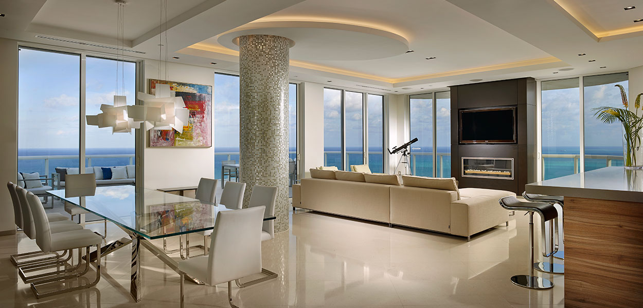 Open-plan kitchen and living area in a breathtaking penthouse by Pepe Calderin Design with unbelievable Miami Beach views