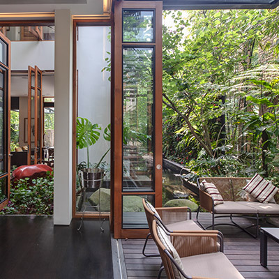Outdoor terrace in stunning garden villa in Singapore by Aamer Architects