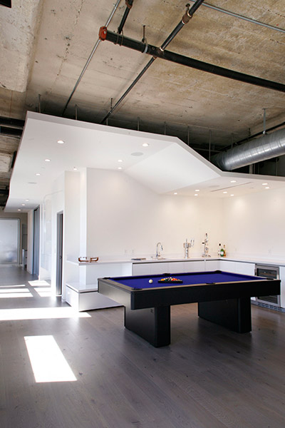 Pool table in modern twin loft in Los Angeles by CHA:COL