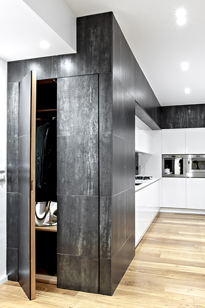 This renovated apartment in Italy by M12 Architettura Design boasts elegant black and white palette and custom cabinets