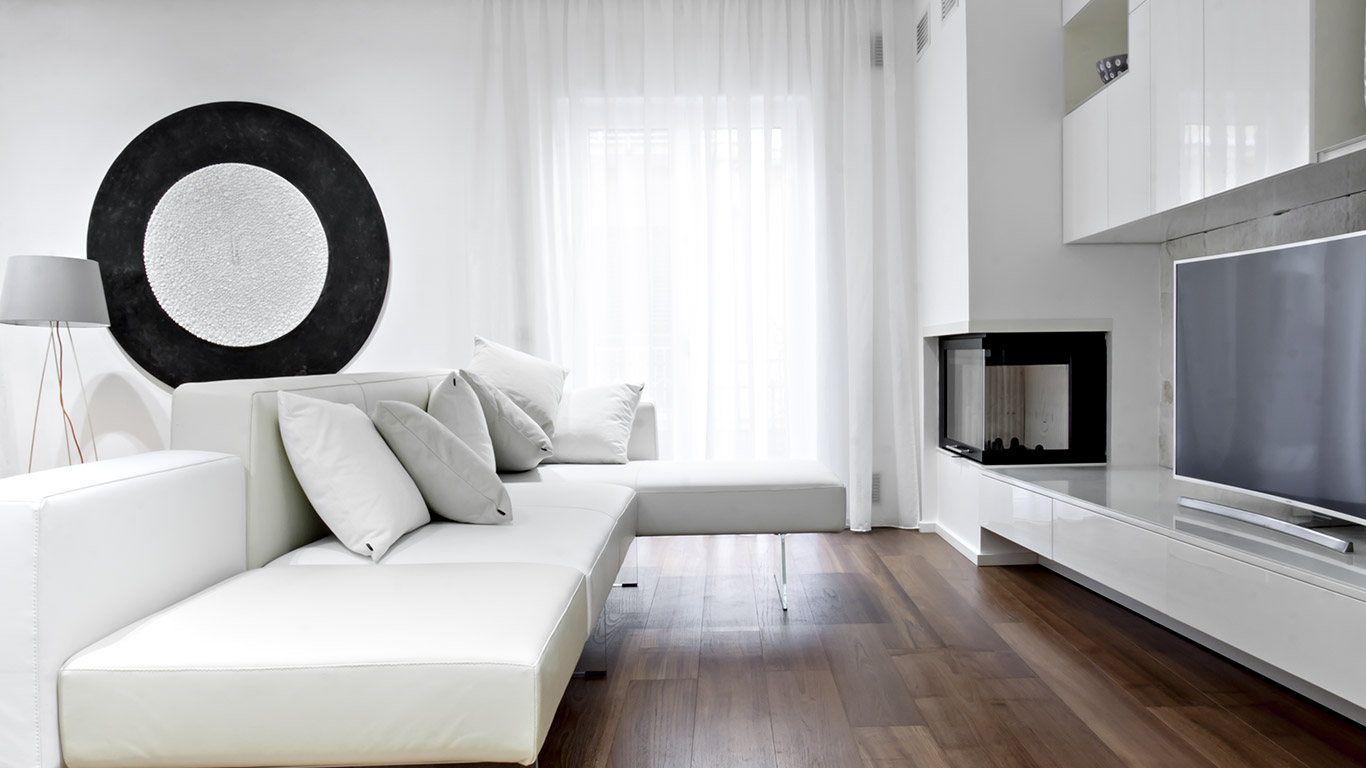 This renovated apartment in Italy boasts elegant black and white palette and custom cabinets