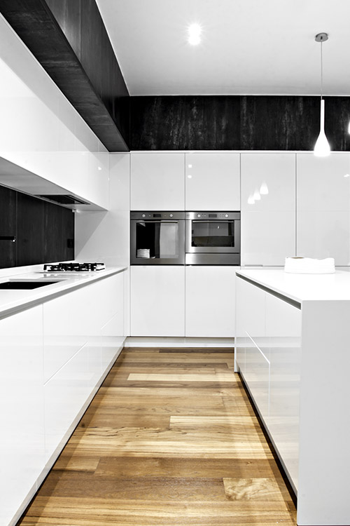 Small black and white kitchen design idea in a renovated apartment located in Italy - SG House by M12 Architettura Design