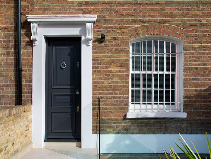 Entrance of a renovated 1800s brick cottage in London by extrArchitecture
