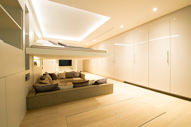 Retractable ceiling bed
