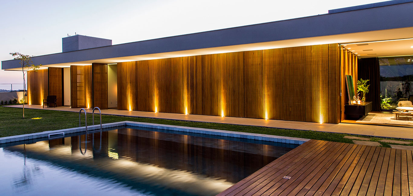 This wooden and concrete single-family house with stunning pool, located near Sao Paulo, was inspired by Brazilian modernism