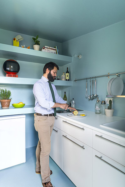 Functional small turquoise blue kitchen in small 28 square meter apartment in Milan, Italy by Studio WOK