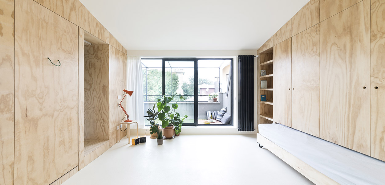 Main living space in small apartment in Milan of only 28 square meters by Studio WOK - with fantastic space saving furniture system