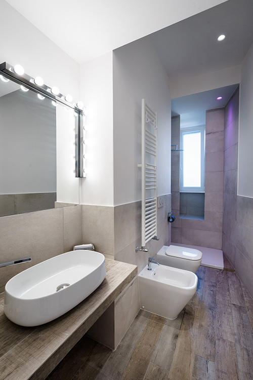 Small bathroom design idea in an all-white minimalist apartment in Rome, Italy