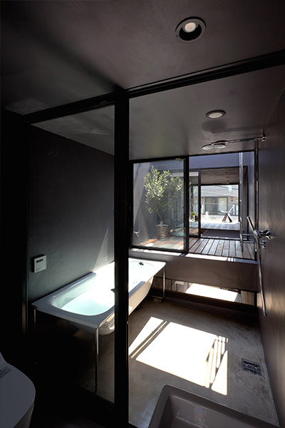 Small bathroom design idea in an extremely narrow 1.8m house in Tokyo, Japan by YUUA Architects