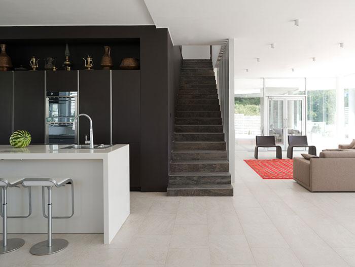 Modern staircase near kitchen area in contemporary Sochi, Russia villa