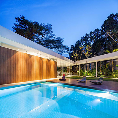Spectacular house in Sao Paulo lets the family sunbathe on the patio and swim in the gorgeous LED light swimming pool - designed by FGMF Architects