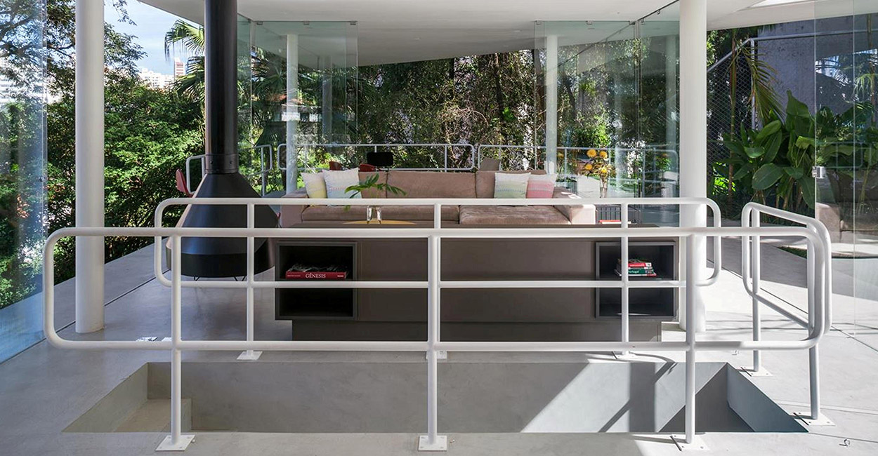 Lots of glazing makes this open plan living room have spectacular views of the garden and outdoor patio with pool -spectacular house in Sao Paulo, Brazil