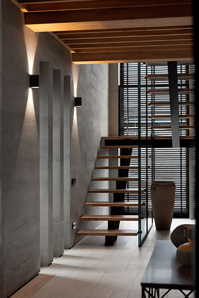 Spectacular wooden staircase in large modern family home in Ukraine