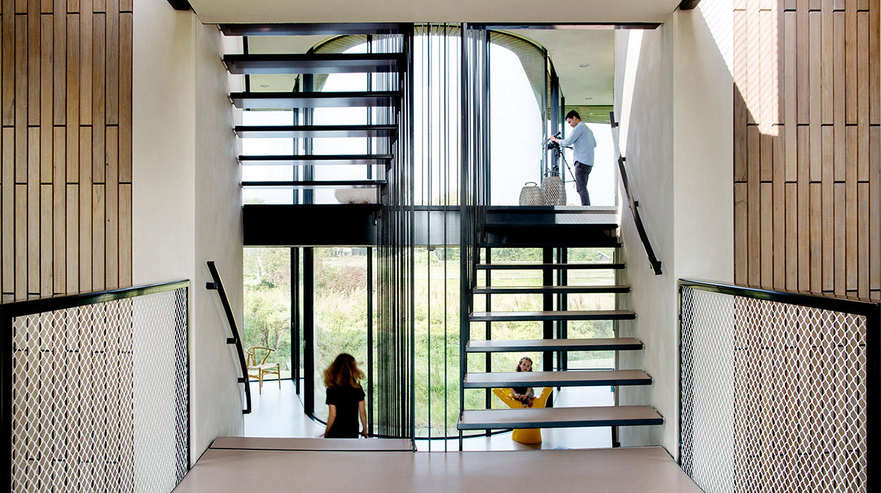Modern staircase in contemporary smart home in The Netherlands by UNStudio