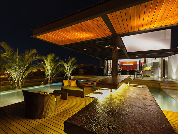 Stunning modern lakeside house terrace at night