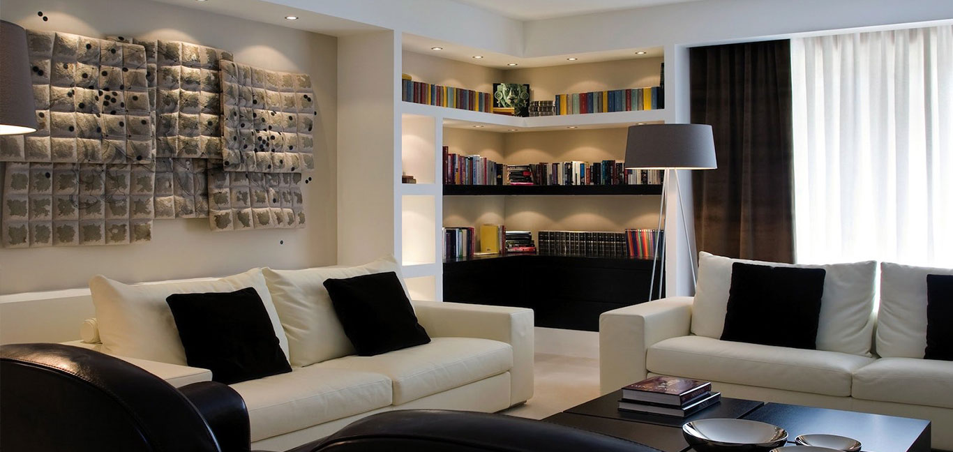 Stylish living room with modern Italian furniture in remodeled duplex apartment - white and beige color palette - designed by Ernesto Fusco