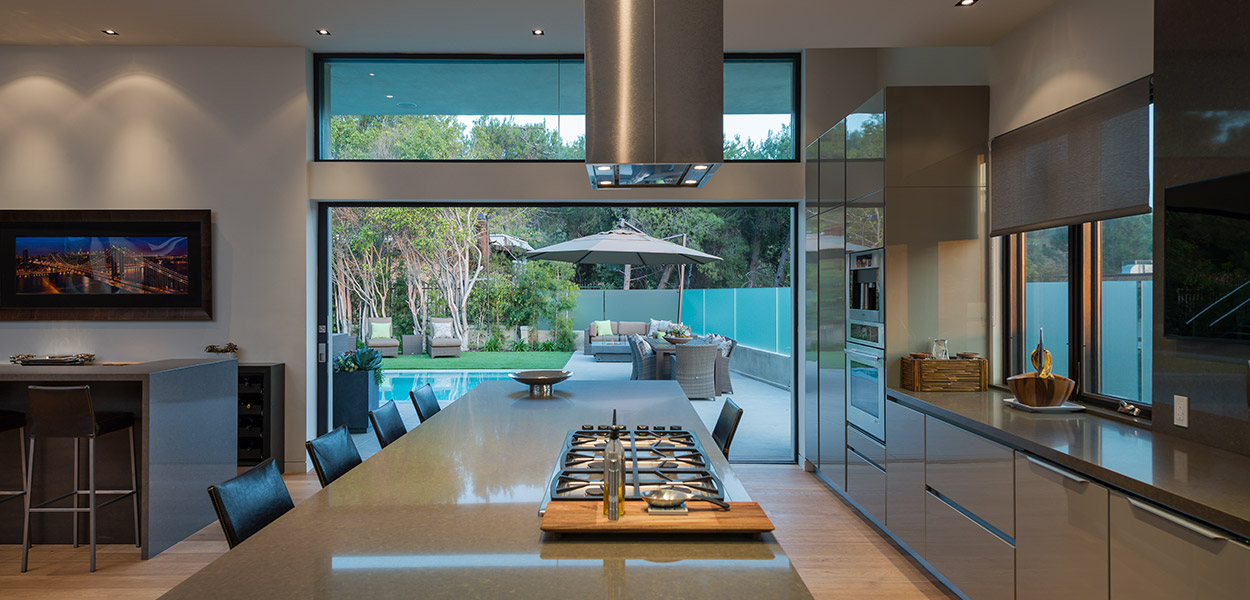 Beautiful modern kitchen open to the living room and outdoor area