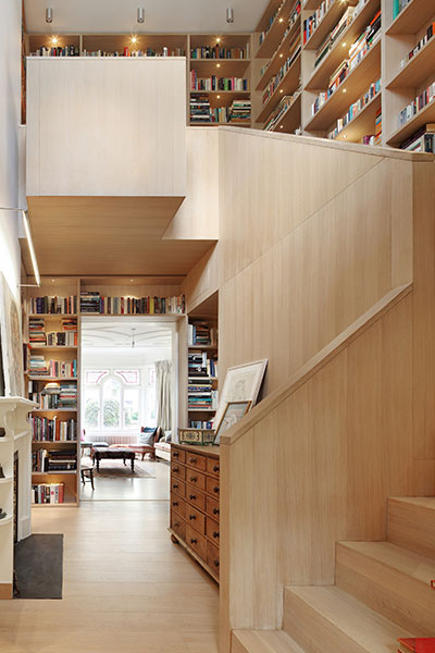 Book Tower House - Bookcases Around Wooden Staircase