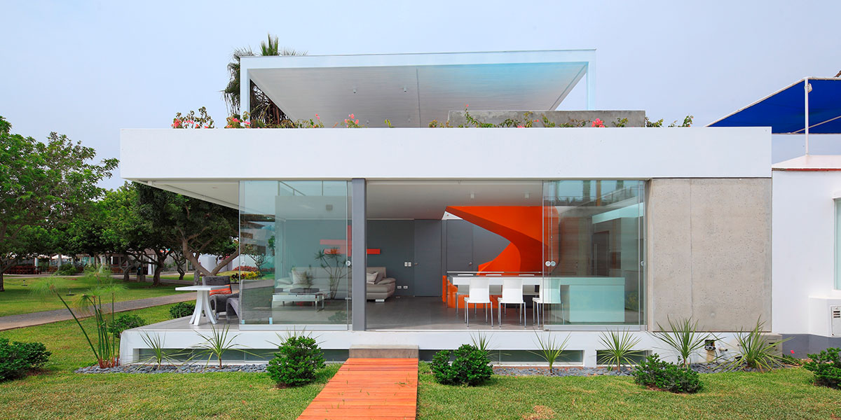 Stunning House In Peru With Orange Spiral Staircase