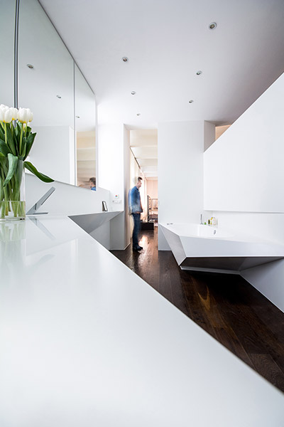 Contemporary bathroom design with geometric bathtub and large sink