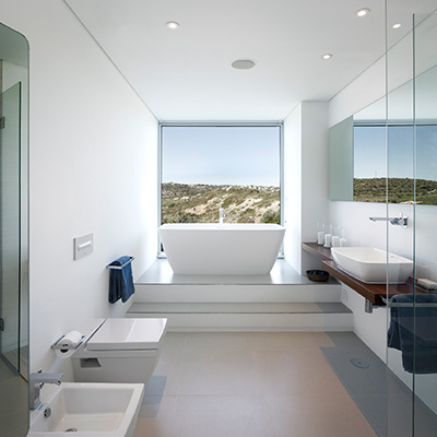 Contemporary white bathroom with stunning view