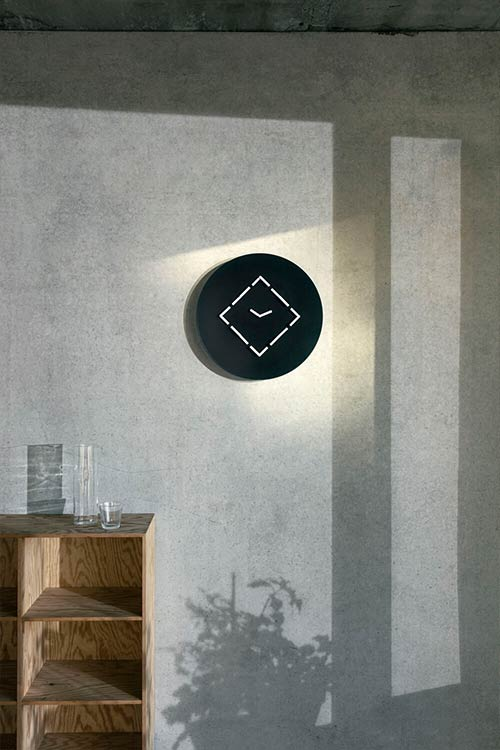ClockClock 9 is both a kinetic sculpture and a functioning wall clock