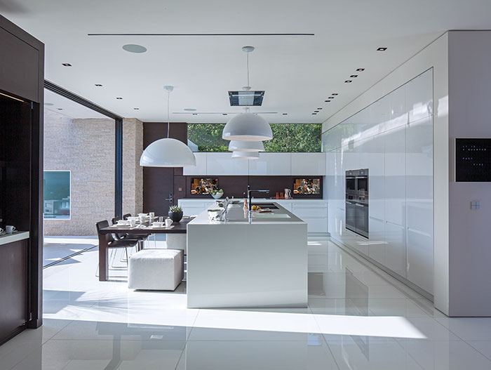 Laurel Way Residence: Luxurious white kitchen by Whipple Russell Architects
