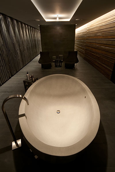 Modern Brown Bathroom With Round Bathtub