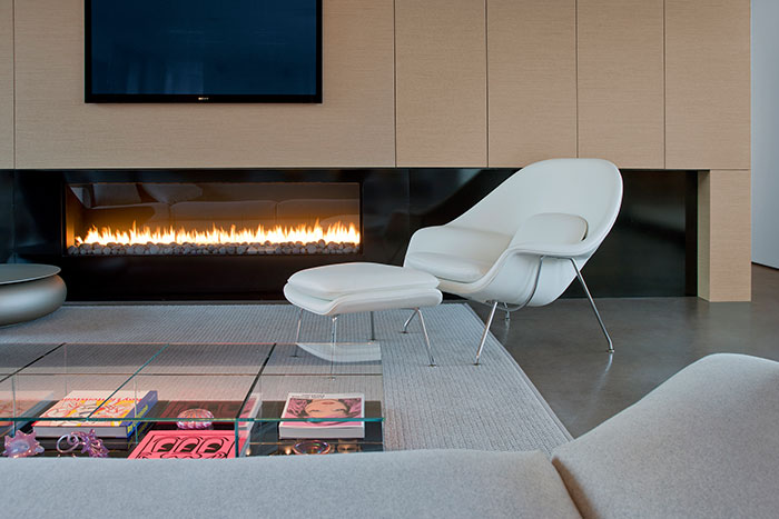 Modern Living Room With White Chair And Beautiful Fireplace
