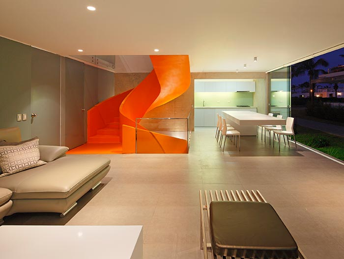 Modern Sofa And Orange Spiral Staircase