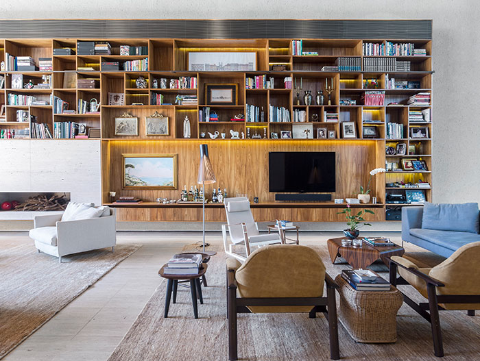 Open plan living area with large bookcase
