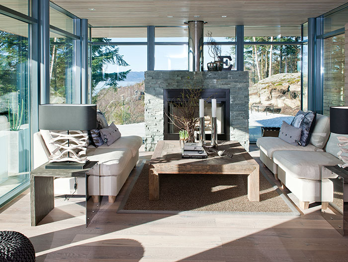 Scandinavian Living Room Design With Modern White Sofa Fireplace And Spectacular View