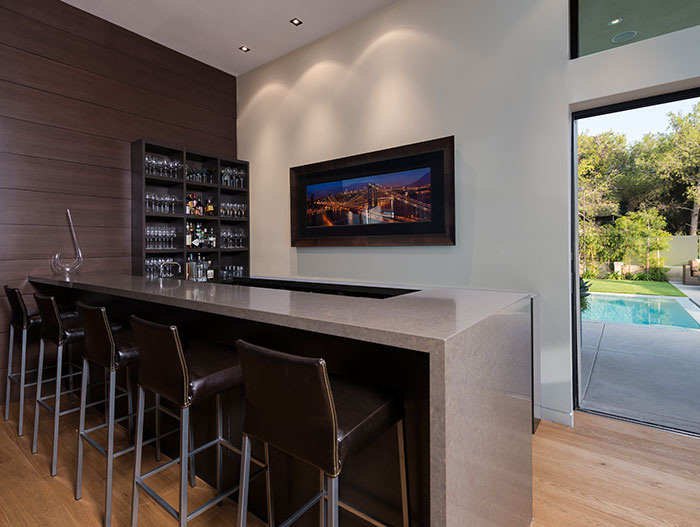 Stylish kitchen open to the living room and outdoor area