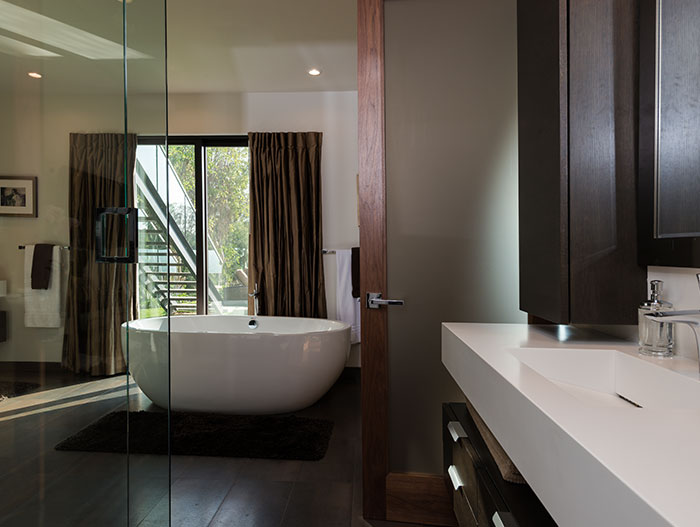 Wallace Ridge by Whipple Russell Architects - Modern bathroom with oval bathtub