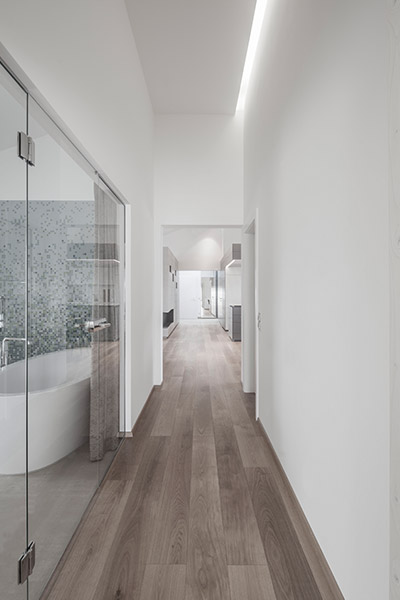 White Hallway Leading To Bathroom