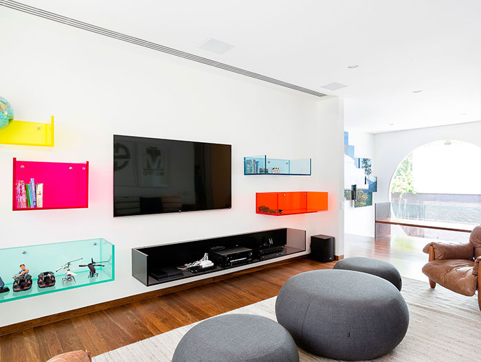 Colorful lounge area inside modern AA House by Pascali Semerdjian Architects