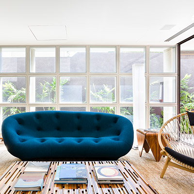 Custom furniture pieces give this modern home in Sao Paulo, Brazil a truly unique look and feel