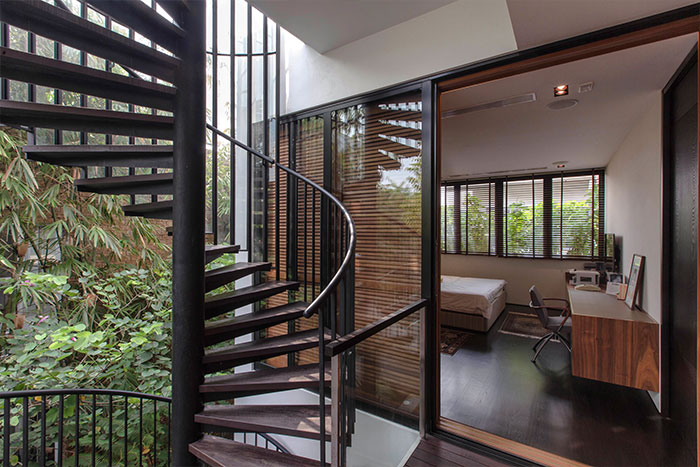 Amazing garden villa with gorgeous spiral staircase by Aaner Architects