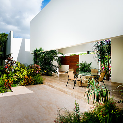 Amazing outdoor and lounge area in award-winning house in Yucatan, Mexico with lush garden and great swing chair