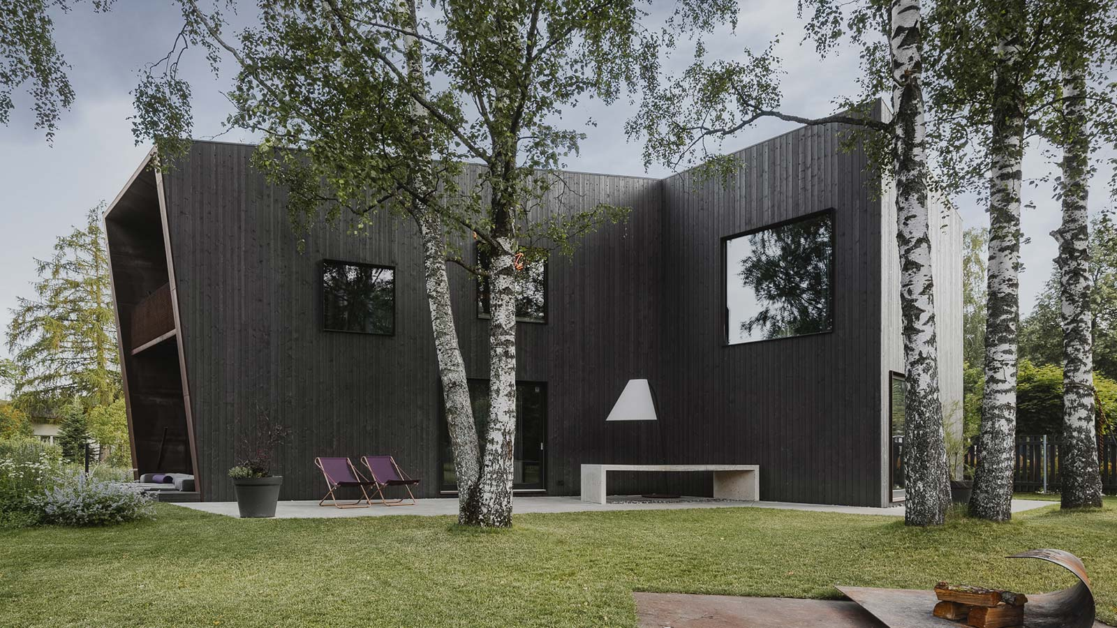 Modern timber house in Riga, Latvia designed by Open AD blends in with the environment